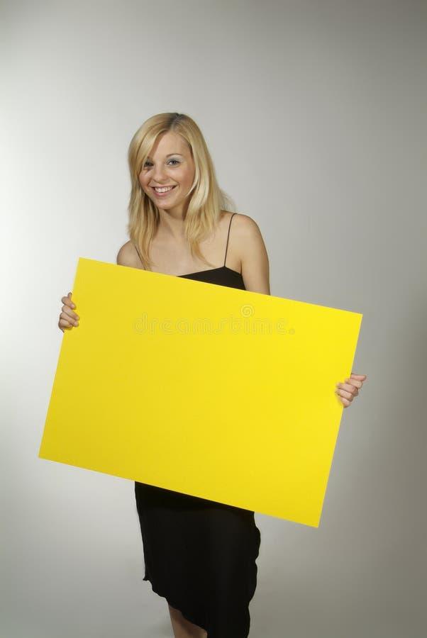 blondynów szyldowy kobiety kolor żółty obraz stock