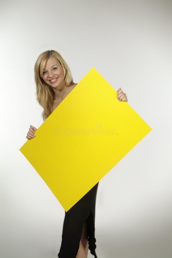 blondynów szyldowy kobiety kolor żółty obrazy stock