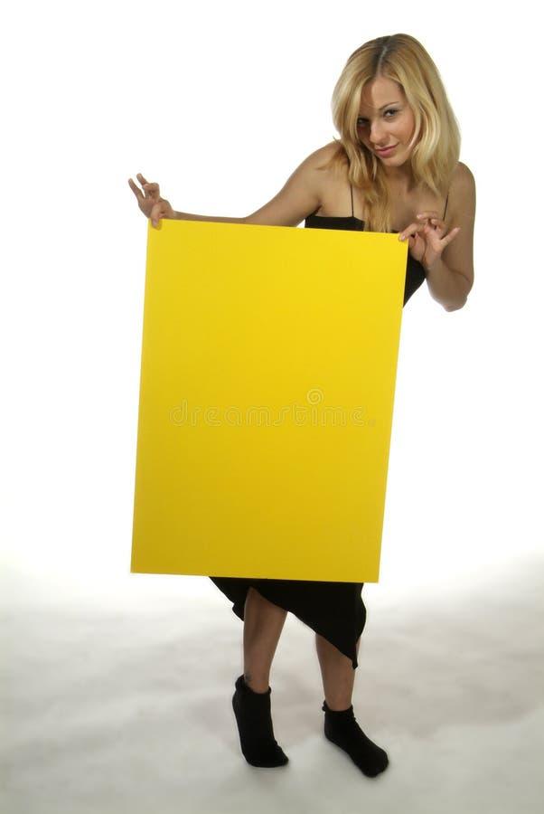 blondynów szyldowy kobiety kolor żółty fotografia stock