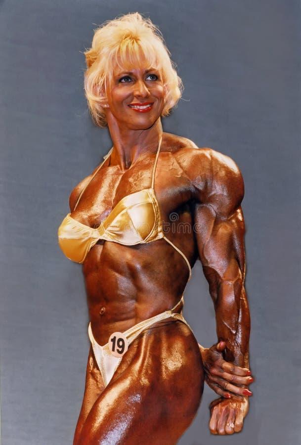 Blondynka, maniak, Bodybuilder zdjęcia royalty free