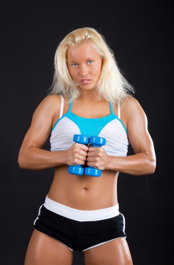 blondynka robi ćwiczeniu seksownemu zdjęcie royalty free
