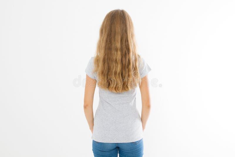Blondynki dziewczyna z długim i falistym zdrowym włosy odizolowywającym na białym tle Młodej kobiety mody fryzury plecy widok bla zdjęcia royalty free