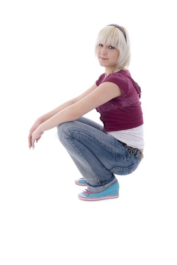 blondynki dziewczyny cajgów boczny siedzący widok zdjęcie royalty free