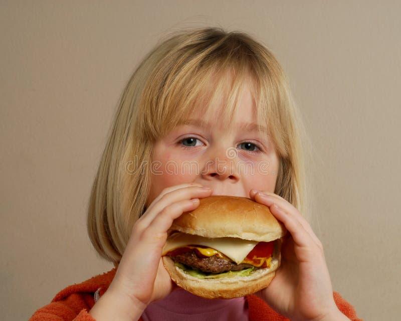 blondynki dziewczyny hamburger obraz royalty free