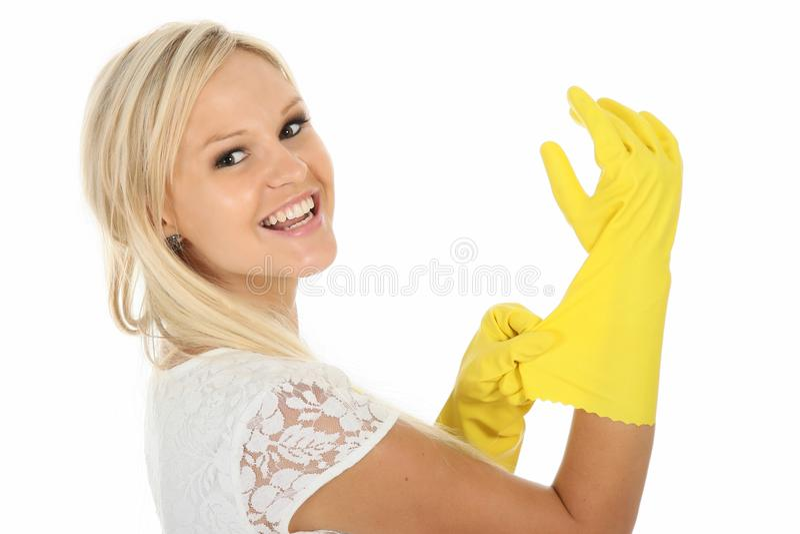 blondynki rękawiczek wspaniały gospodyni domowej lateksu kolor żółty obraz stock