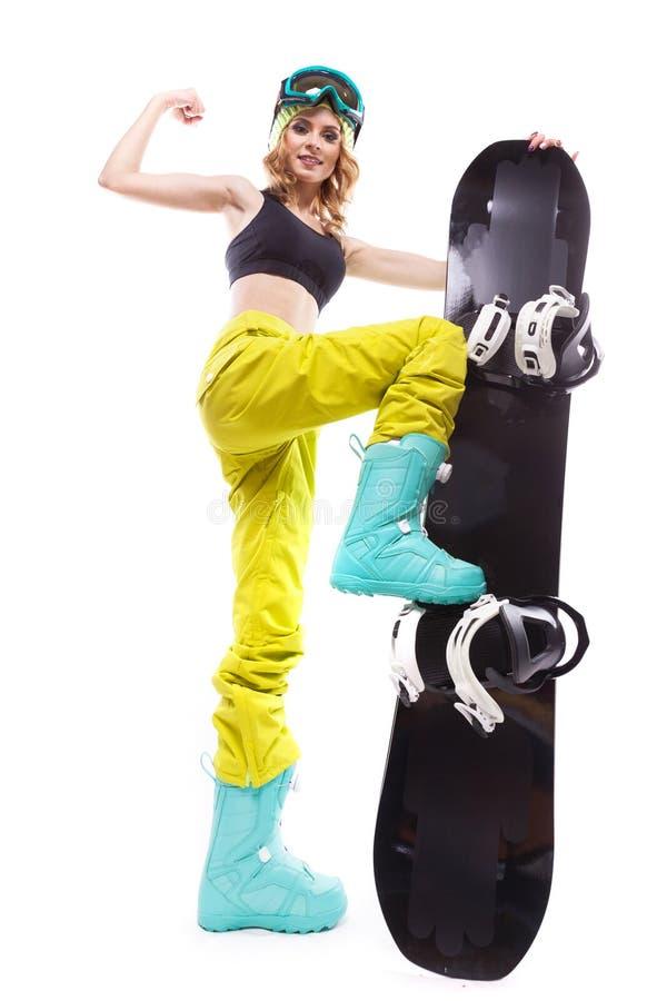 Blondynki szczupła dziewczyna z snowboard obrazy royalty free