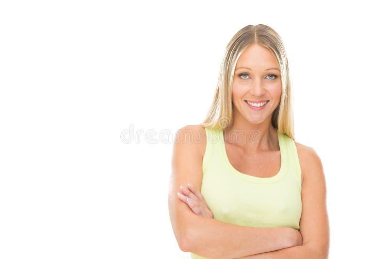 Blondynki uśmiechnięta młoda kobieta z zieleni suknią odizolowywającą na bielu zdjęcie stock
