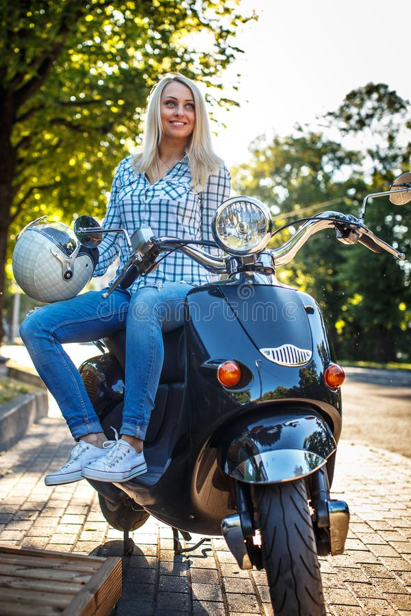 Blong girl in blue jeans and t-shirt royalty free stock photography