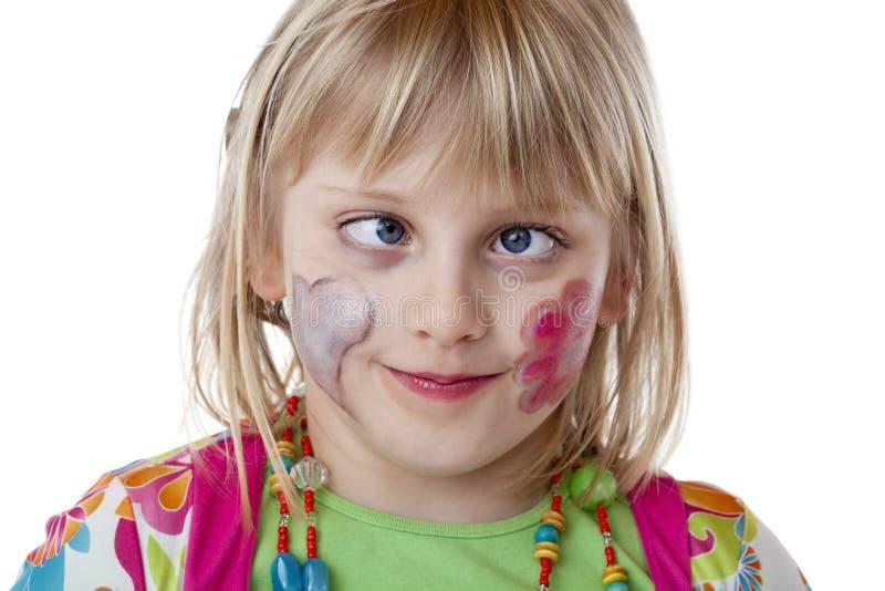 blont flickastrabismusbarn arkivbild