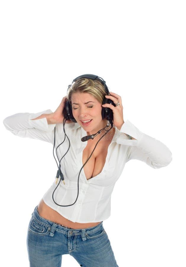 Blont med hörlurar med mikrofon royaltyfri foto