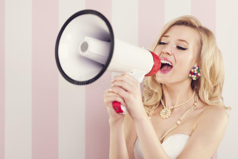 Blont ropa för kvinna royaltyfri foto