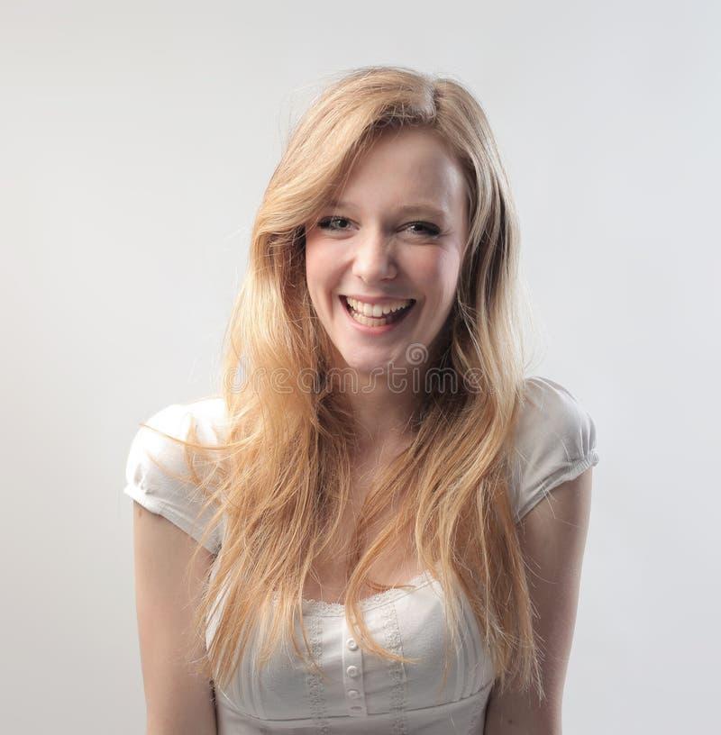 Blont skratta för skönhet royaltyfria foton