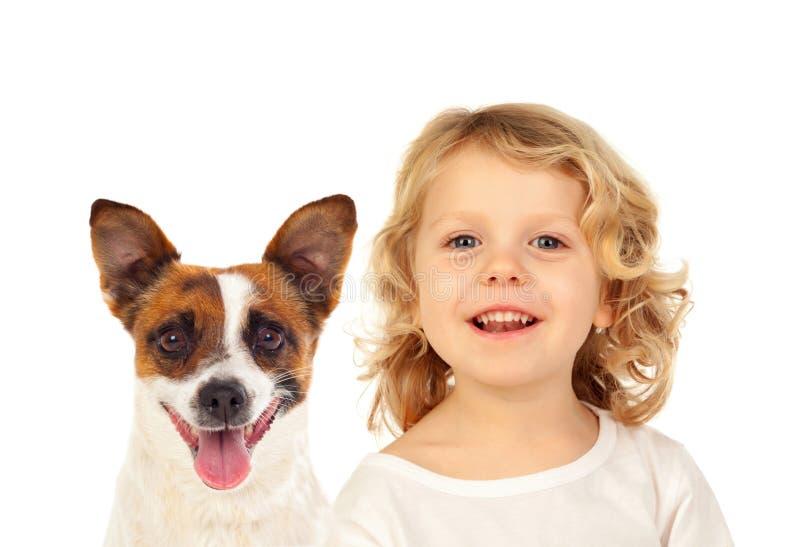 Blont småbarn med hans hund royaltyfria bilder