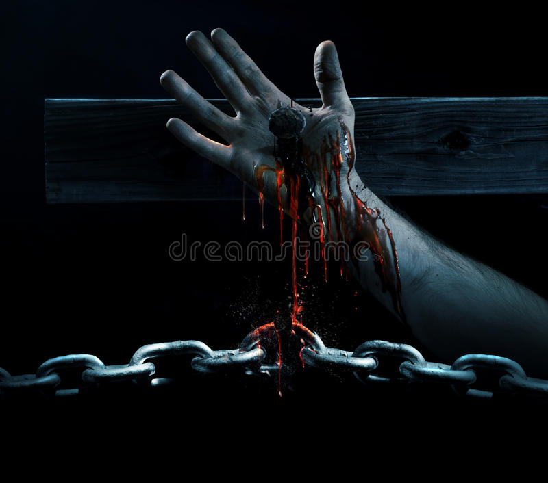 Blood breaking the chains. The blood of Jesus drips down and breaks a chain royalty free stock image