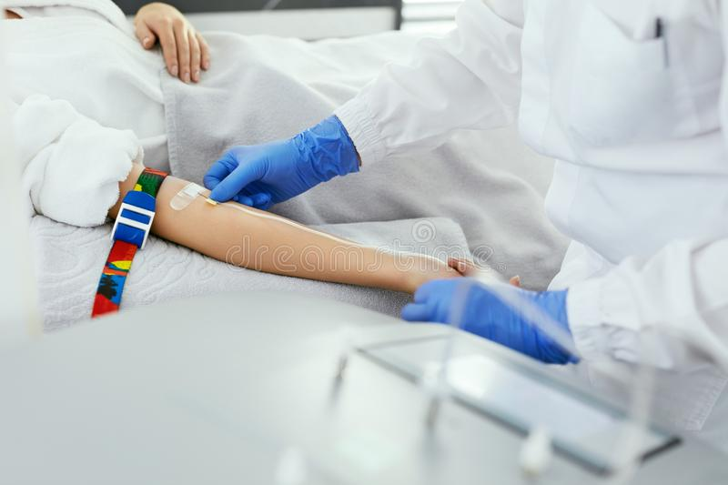 Blood Donation. Doctor Inputting Needle With Dropper In Arm stock images