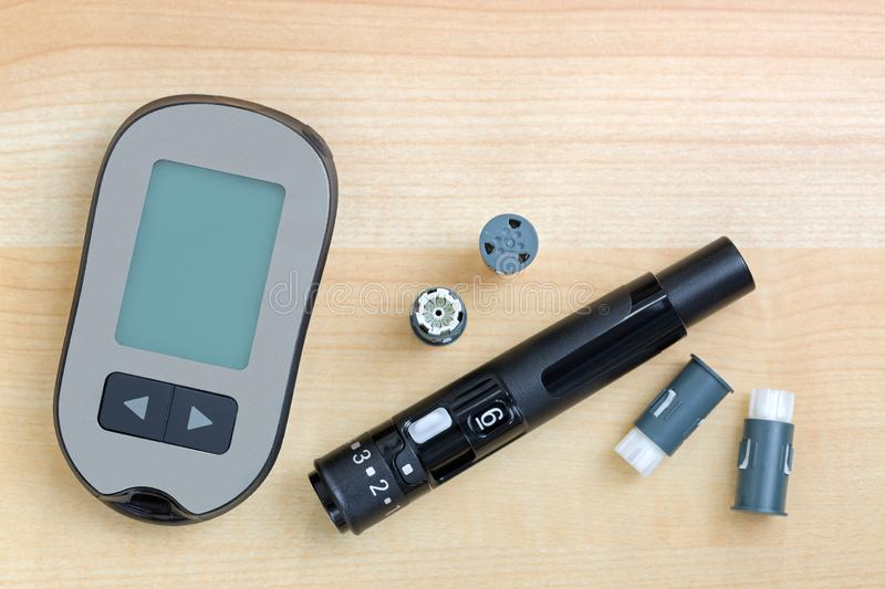 Blood Glucose meter with finger pricker, lancing pen device kit with drum to check blood Glucose. Blood Glucose meter with finger pricker, lancing pen device kit royalty free stock images