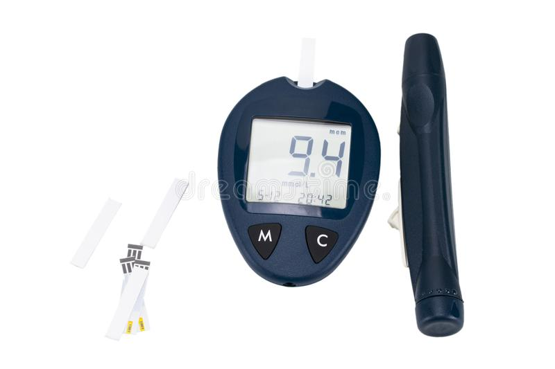 The blood glucose meter with test strips isolated on white background royalty free stock image