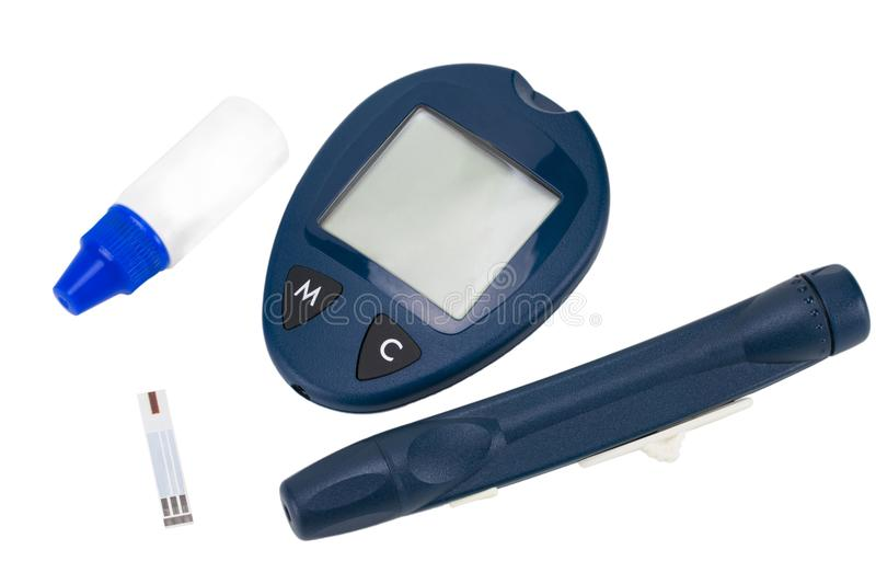 The blood glucose meter with test strips isolated on white background royalty free stock photography