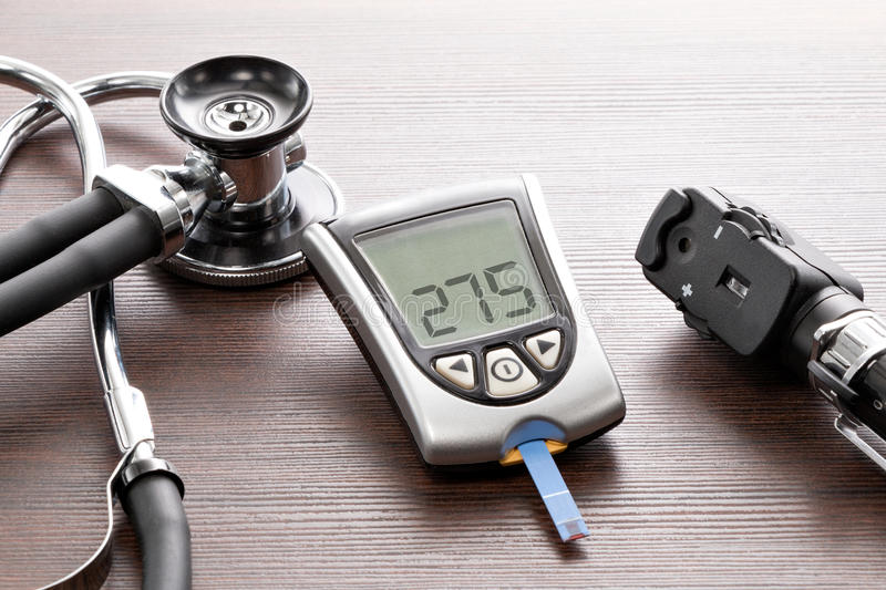 Blood glucose meter to check the blood sugar level. Glucose concentration in the blood test with a blood glucose meter royalty free stock photo