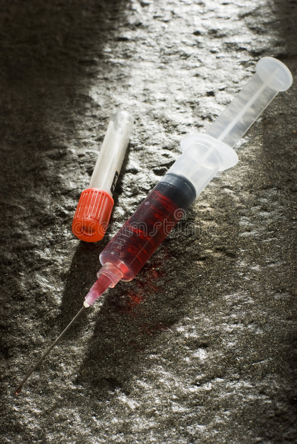 Download Blood in injection syringe stock photo. Image of medical - 6018486