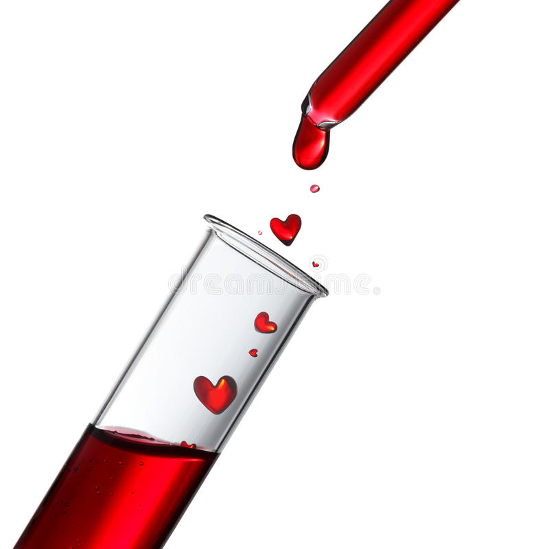 Blood or love potion drops in heat shape stock images