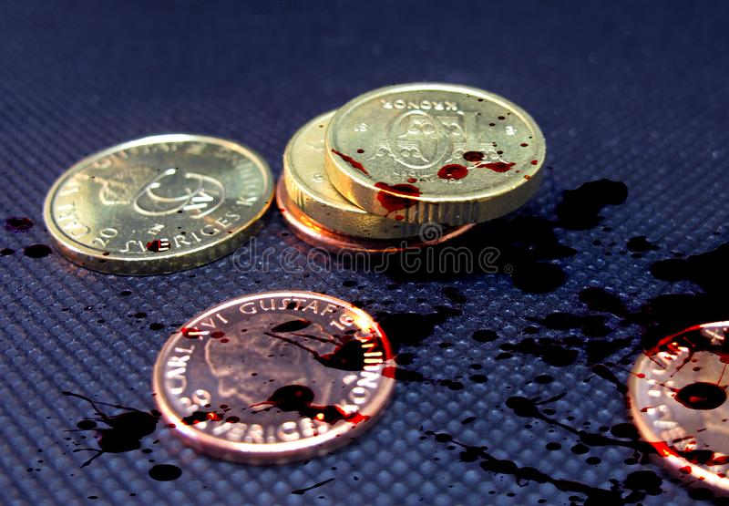Blood money coins from Sweden royalty free stock photo