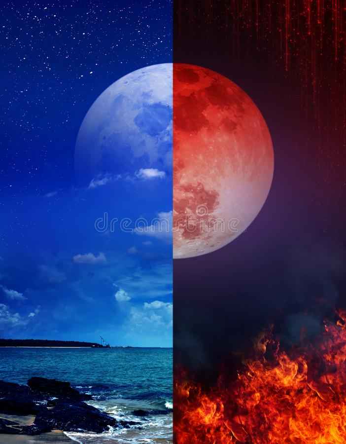 The blood moon above the fire and the super moon above the sea royalty free stock photography