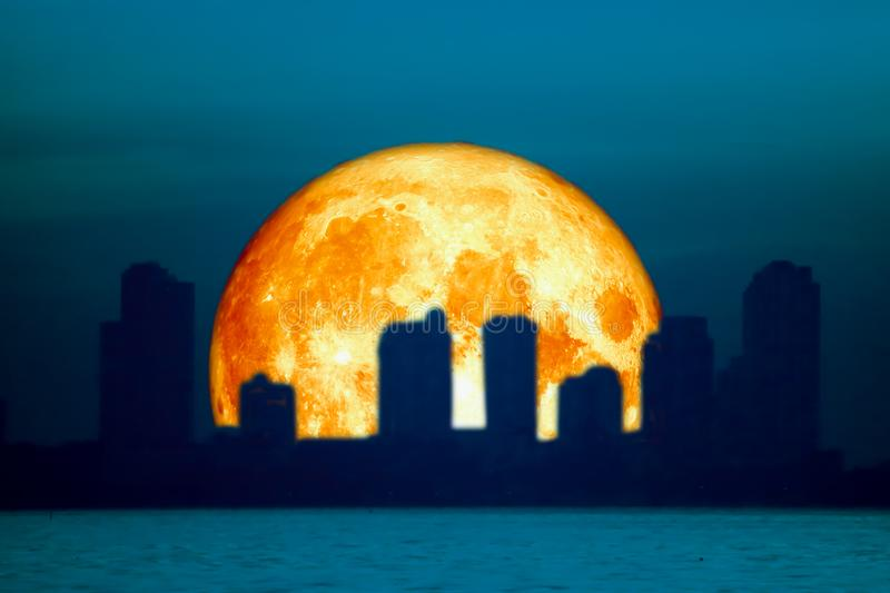 blood moon back silhouette building over city night sky stock image
