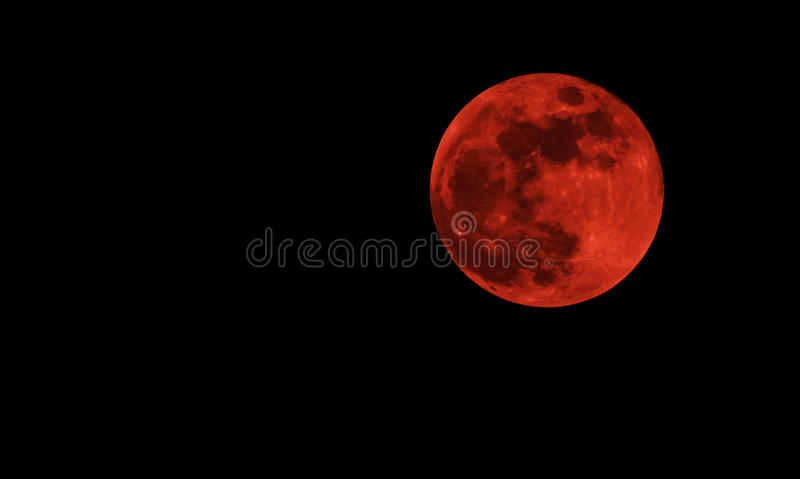 Blood red moon. Concept of a red full moon against a black sky royalty free stock photo