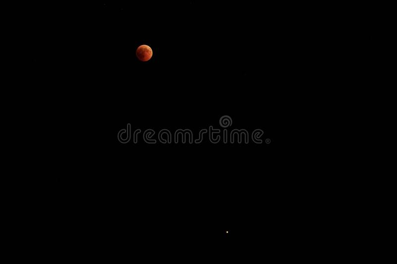 Blood Moon 2018: Longest Total Lunar Eclipse of Century in july, Moon and Mars planet opposition. Night photography. Telescopic royalty free stock images