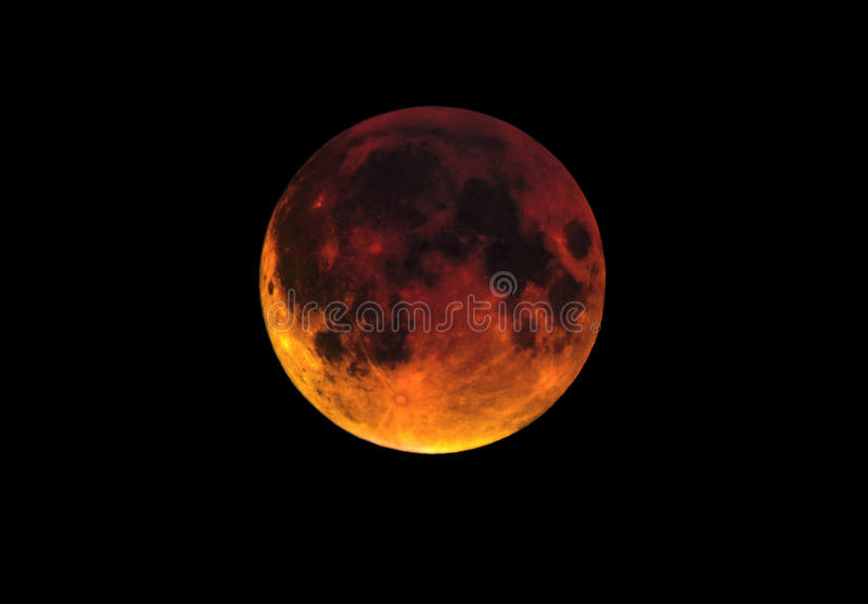 Blood moon luna eclipse. This luna eclipse is also known as a blood moon as the moon goes into the shadow of the earth it goes a reddish colour stock image