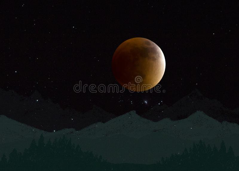 Blood moon above the mountains stock photography