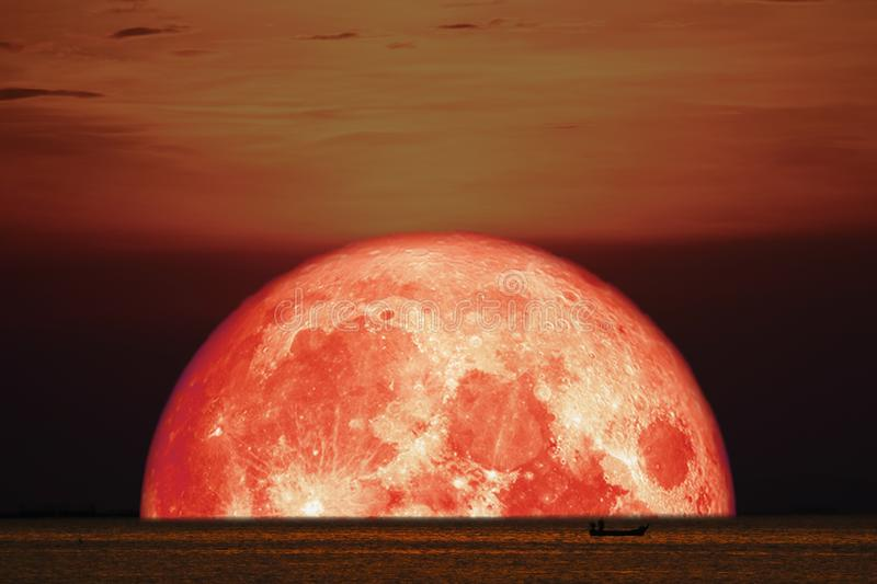 Blood moon on night sunset sky back horizon sea. Elements of this image furnished by NASA, apogee, background, bloody, bright, buck, cloud, corn, country, dark stock photography