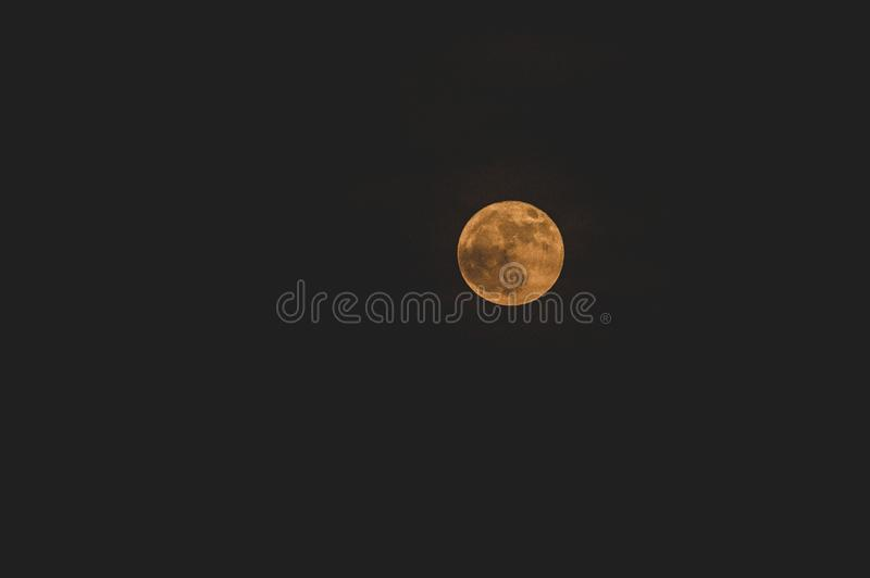 Blood moon in the sky. Dark quiet night under the stars royalty free stock photo