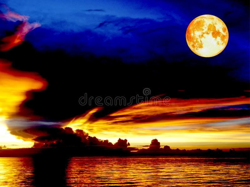 Blood moon sunset sea ship on horizon line bird fly on night cloud. Blood moon sunset sea ship on horizon line and bird fly on night cloud stock photo