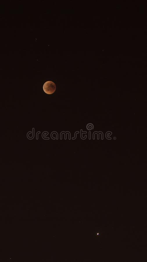 Blood Moon and Venus. Image showing blood moon and Planet Venus on the same frame during eclipse of the moon, shot in Izmir, Turkey royalty free stock images