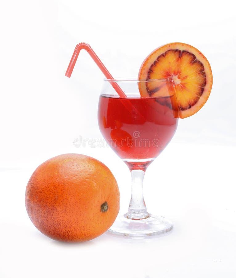 Blood orange cocktail with slices of blood orange royalty free stock image
