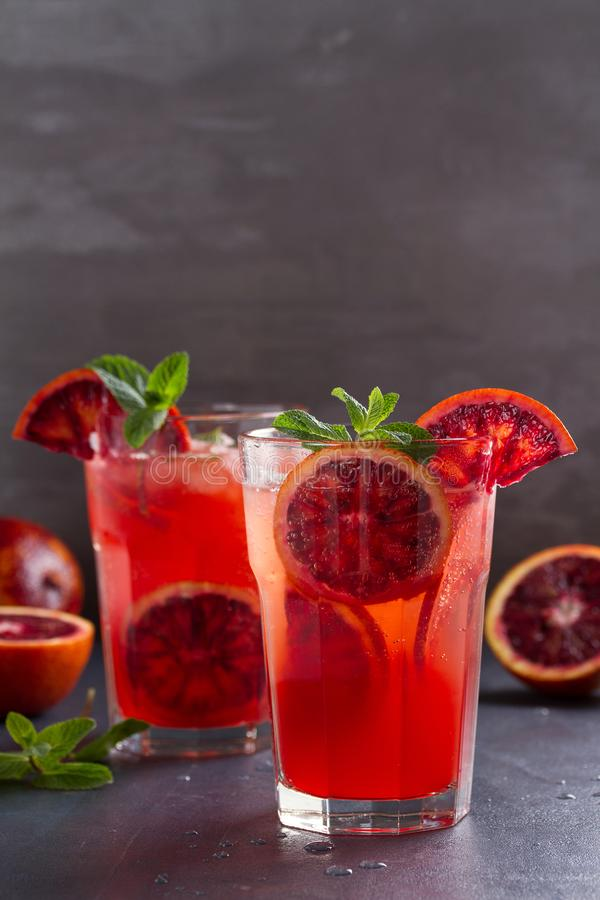 Blood orange cocktail with slices of citrus fruits and mint. stock photo