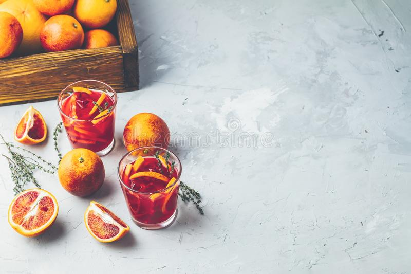 Blood Orange Margarita cocktail with ice and thyme stock photos