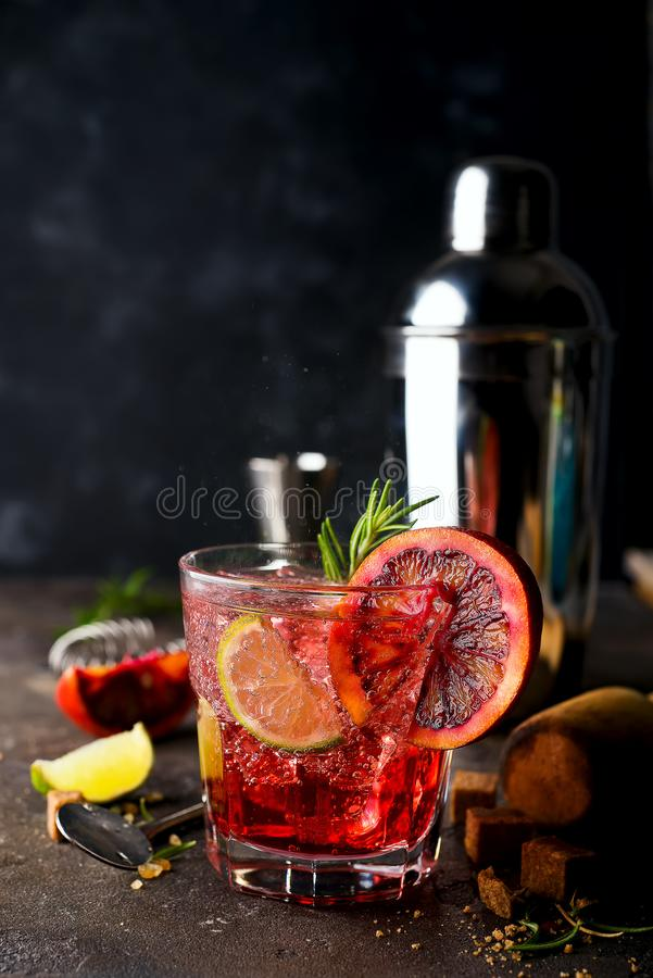 Blood Orange Margarita coctail with ice and thyme on dark backgorund royalty free stock photos
