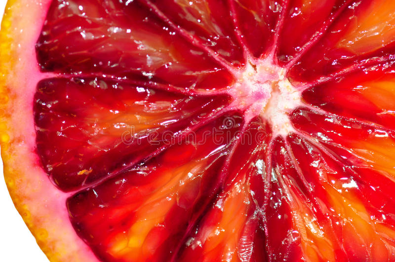 Blood Orange Slice. A macro shot of a blood orange royalty free stock images