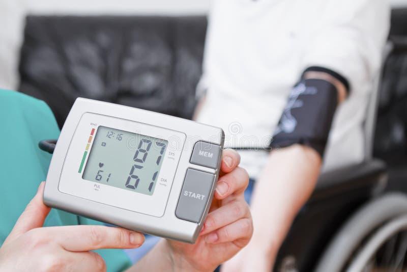 Blood pressure check stock photo