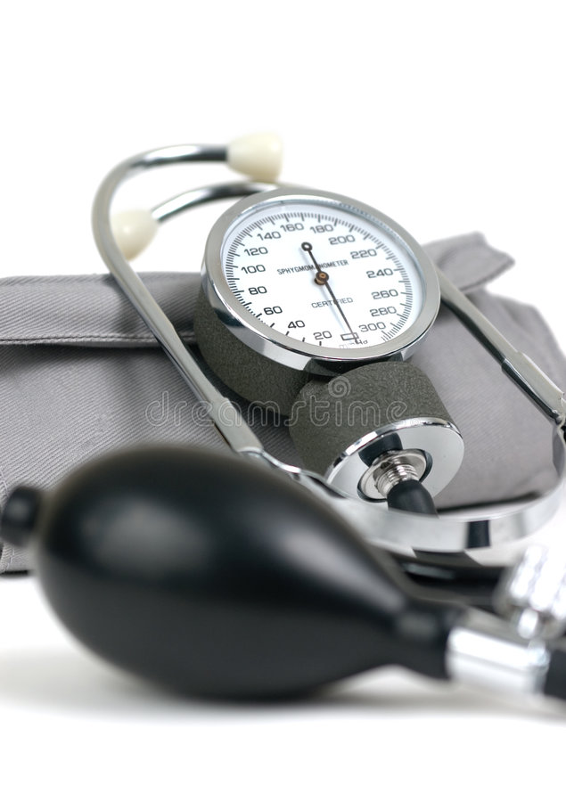 Blood pressure cuff. And stethoscope isolated on white stock photos
