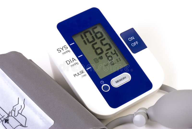 Blood pressure cuff. Closeup of a home style blood pressure cuff (sphygmomanometer) showing a normal blood pressure stock photos