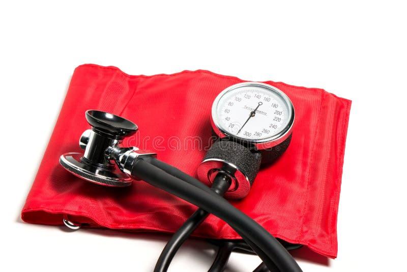 Blood pressure cuff, close-up. Red Blood pressure cuff, close-up issolated stock images