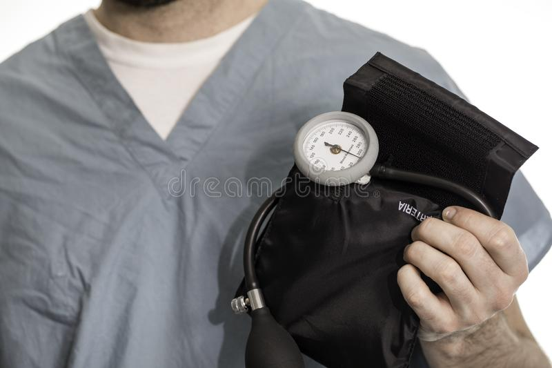 Blood Pressure Cuff. Nurse, doctor, or surgeon holding a blood pressure cuff royalty free stock photos
