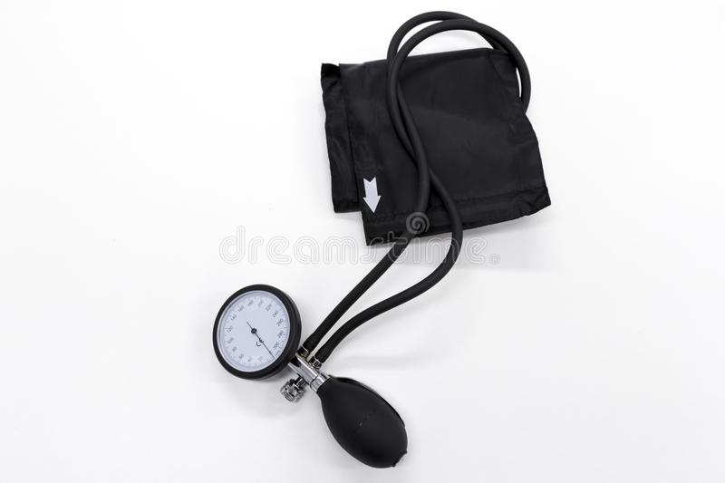 Blood pressure cuff. Sphygmomanometer or blood-pressure cuff on a white background royalty free stock image
