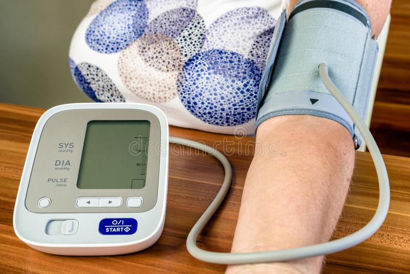 Blood pressure and heart rate monitor stock photos