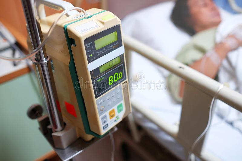 Blood pressure measurement monitor in hospital with old female patient. royalty free stock photography