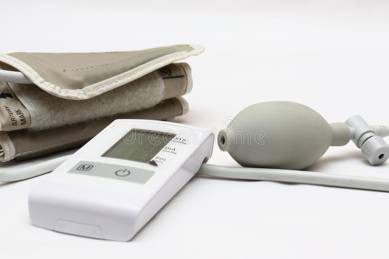 Blood pressure measurement with a tonometer. Cuff for air, pear for inflation, connecting ducting soft rubber tubes. Blood pressure measurement with a tonometer stock image